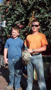 3 boys at the christmas tree