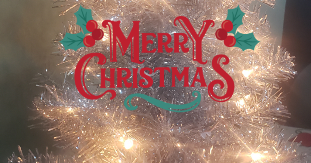 Merry Christmas on a lighted tinsel tree background.