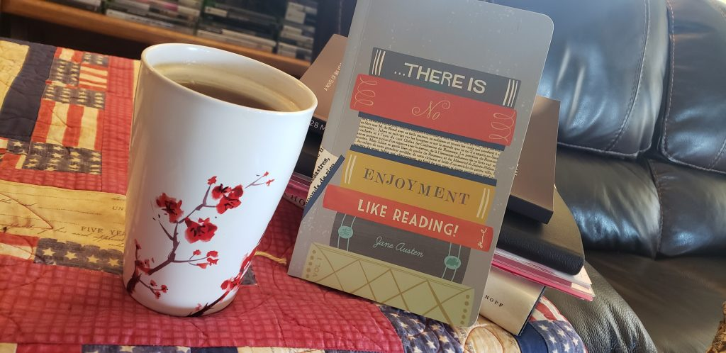 Cup of tea and a book journal.