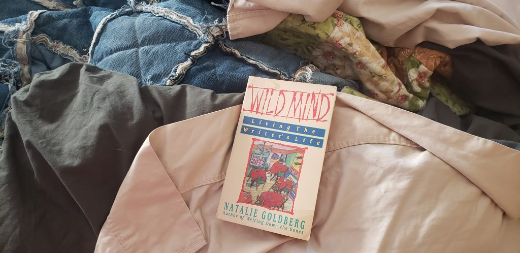 Inspiration for Writing in the form of a book. Wild Mind cover on a pile of blankets.
