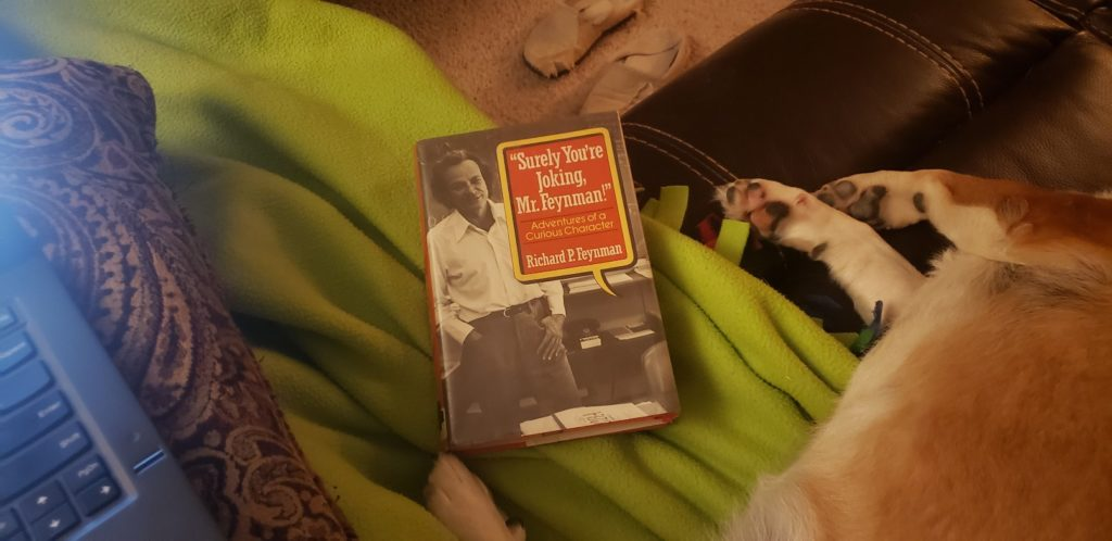 The Mr. Feynman book cover on the couch with the dog.