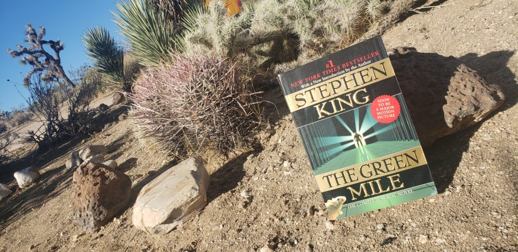 The Green Mile by Stephen King book cover on a desert background.